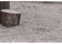 Sand und Holzklotz